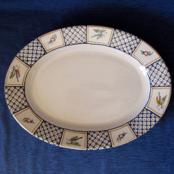 piatto-da-portata-in-maiolica-ovale-grate.jpg